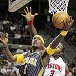 Person who phoned in bomb threat for Pacers locker room when they returned to the Palace. Indiana's Stephen Jackson slides under Detroit's Ben Wallace for a layup in the first quarter.