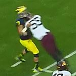 UofM Coaching allowing Quarterback to continue play after this hit and subsequent stumbling on the field after.